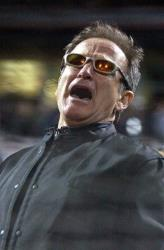 In this Oct. 22, 2002 file photo, actor Robin Williams sings Take Me Out to the Ballgame in the seventh inning during game 3 of the World Series in San Francisco.