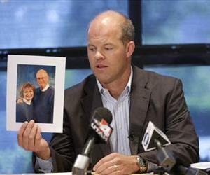 Attorney Paxton Guymon holds a photograph of Jim and Jan Harding during a news conference in Salt Lake City on Thursday, Aug. 14, 2014.