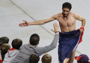 France's Mahiedine Mekhissi-Benabbad celebrates shirtless after a previous win.