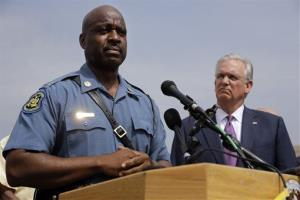 Capt. Ron Johnson of the Missouri Highway Patrol, left, and Missouri Gov. Jay Nixon take part in a news conference Friday, Aug. 15, 2014, in Ferguson, Mo.