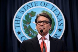 Gov. Rick Perry makes a statement at the capitol building in Austin, Texas on Saturday, Aug. 16, 2014.