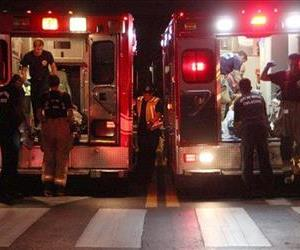 Emergency workers treat the injured in ambulances in a different emergency on Friday night, July 4, 2014.
