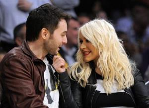 Christina Aguilera and Matt Rutler watch the Los Angeles Lakers play the Oklahoma City Thunder in their NBA basketball game, Thursday, March 29, 2012, in Los Angeles.