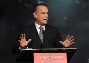In this Jan. 4, 2014 file photo, Tom Hanks accepts the Chairman's award for Captain Phillips and Saving Mr. Banks at the Palm Springs International Film Festival Awards Gala in Palm Springs, Calif.