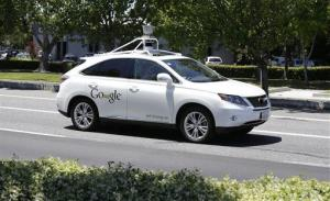 In this photo taken May 14, 2014, a Google self-driving car goes on a test drive near the Computer History Museum in Mountain View, Calif.