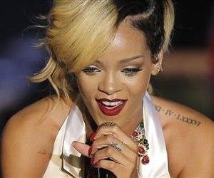 In this 2013 file photo, Rihanna performs in Monaco during her Diamonds World Tour.