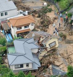 Heavily damaged houses are seen after a massive landslide swept through residential areas in Hiroshima, western Japan today.