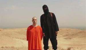 A frame grab from a video released by Islamic State militants that purports to show the killing of journalist James Foley by the militant group.
