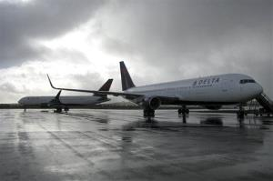 This Oct. 30, 2013 photo released by the State of Alaska Central Region Department of Transportation & Public Facilities shows a Delta Airlines plane on a runway, at right, in Cold Bay, Alaska.