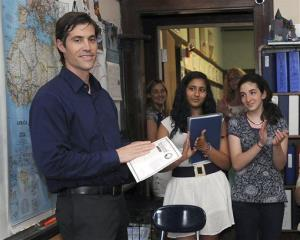 In this June 17, 2011, photo, journalist James Foley receives applause from students at the Christa McAuliffe Regional Charter Public School in Framingham, Mass.