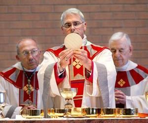 In this Feb. 11, 2011 photo, Archbishop Paul Coakley is installed as the fourth archbishop of the Oklahoma City Archdiocese in a ceremony at St. John the Baptist Catholic Church, in Edmond, Okla.