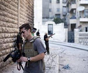 FILE - This September 2012 file photo posted on the website freejamesfoley.org shows journalist James Foley in Aleppo, Syria.In a horrifying act of revenge for U.S. airstrikes in northern Iraq, militants with the Islamic State extremist group have beheaded Foley — and are threatening to kill another hostage,...