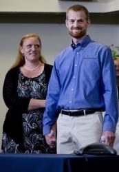 Ebola victim Dr. Kent Brantly stands with his wife, Amber, during a news conference at Emory University Hospital.