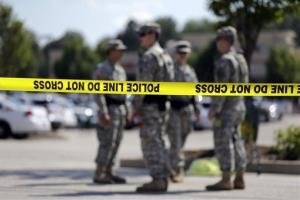 Members of the Missouri National Guard stand guard over a police command post Tuesday in Ferguson, Mo.