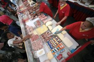 People buy government-subsidized food at a state-run market in Caracas.