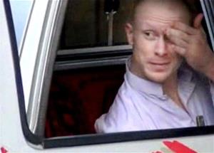 Bowe Bergdahl sits in a vehicle guarded by the Taliban in eastern Afghanistan just before the prisoner trade.