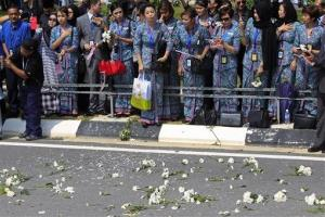 Flowers are laid along a roadside leading from Kuala Lumpur International Airport today.