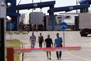 Trucks of the Russian aid convoy are searched at a Russian inspection zone inside a border control point with Ukraine in the Russian town of Donetsk.