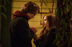 This image released by Warner Bros. Pictures shows Jamie Blackley, left, and Chloe Grace Moretz in a scene from If I Stay.
