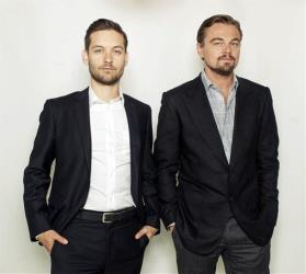 In this April 28, 2013, photo, Leonardo DiCaprio and Tobey Maguire pose for a photo in promotion of 'The Great Gatsby.'
