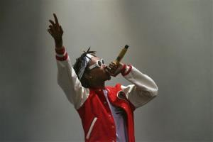 Wiz Khalifa performs on stage during day one of the Wireless Festival at Perry Park in Birmingham, England, Friday July 4, 2014.