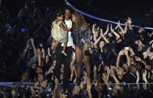 Beyonce on stage hugs Jay-Z and their daughter Blue Ivy as she accepts the Video Vanguard Award at the MTV Video Music Awards at The Forum on Sunday, Aug. 24, 2014, in Inglewood, Calif.
