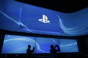 Attendees take pictures at  the Sony's Playstation presentation ahead of the Electronic Entertainment Expo on Monday, June 9, 2014, in Los Angeles. The spotlight at this week's E3 is expected to shift to games.