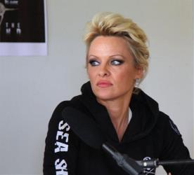 Actress and animal rights activist Pamela Anderson holds a press conference in T?rshavn, Faroe Islands, on Friday, Aug.1, 2014.