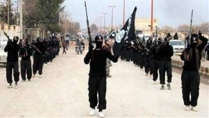 This undated file image posted on a militant website in January shows fighters from the group Islamic State in Raqqa, Syria.