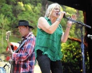 Pegi Young & The Survivors perform with her husband, Neil Young, during the Farm Aid 2013 concert in Saratoga Springs, N.Y.