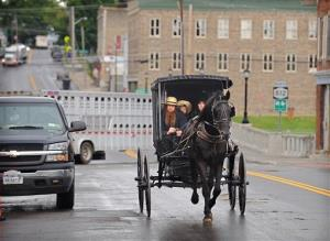 An Amish family rides along Route 812 in Heuvelton, NY, near where the two girls were abducted.