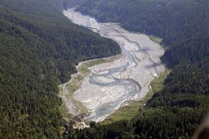 The Elwha River flows freely through what was Lake Mills and past the old Glines Canyon Dam, bottom, in Olympic National Park near Port Angeles, Wash.