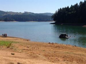 Rescue personnel search Henry Hagg Lake, a reservoir in Gaston, Ore., west of Portland, Tuesday, Aug. 26, 2014.
