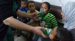 In this image taken from video obtained from the Shaam News Network, posted on April 16, 2014, children are seen receiving oxygen in Kfar Zeita, a rebel-held village in Hama province in Syria.