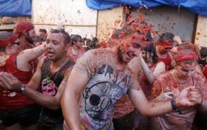 People throw tomatoes at each other during the annual Tomatina fiesta in the village of Bunol, outside Valencia, Spain, on Aug. 27, 2014.