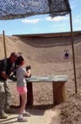Firing range instructor Charles Vacca, left, is seen with the 9-year-old moments before the deadly accident.