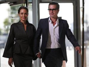 Angelina Jolie and Brad Pitt arrive at the End Sexual Violence in Conflict summit in London, Friday, June 13, 2014.