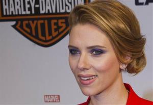 Scarlett Johansson poses for photographers at the French premiere of the film 'Captain America: The Winter Soldier', at the Rex Cinema,  in Paris, Monday, March 17, 2014.
