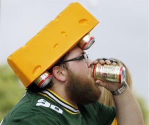 Green Bay Packers fan Joseph Yoshizumi drinks a beer before an NFL preseason football game against the Oakland Raiders Friday, Aug. 22, 2014, in Green Bay, Wis.