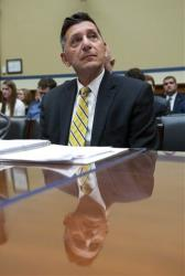 Michael Botticelli, deputy director, Office of National Drug Control Policy, listens while testifying on Capitol Hill in Washington, Tuesday, Feb. 4, 2014.