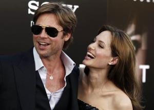In this Monday, July 19, 2010, file photo, Angelina Jolie and Brad Pitt arrive at the premiere of Salt in Los Angeles.
