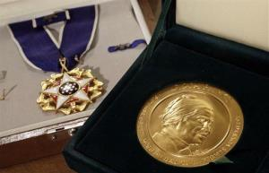 Rosa Parks' Presidential Medal of Freedom, left, and her Congressional Gold Medal.