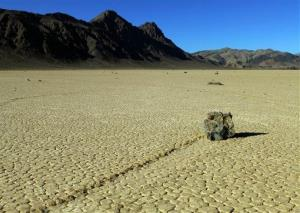 This undated photo provided by the National Park Service shows rocks that have moved across a dry lake bed in Death Valley National Park in California's Mojave Desert.
