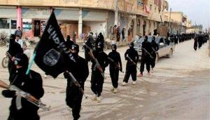 This undated image posted on a militant website in January shows fighters from the Islamic State marching in Raqqa, Syria.