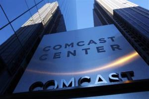 In this Dec. 3, 2009 file photo, a sign outside the Comcast Center, left, is shown in Philadelphia.