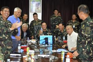 In this photo from Philippine armed forces, military chief Gen. Gregorio Catapang, center, reacts after learning about the safe repositioning of Filipino peacekeepers.