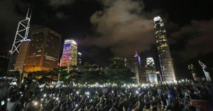 Protesters wave their mobile phones during a rally in Hong Kong last night.