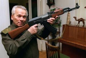 In this Oct. 29, 1997, file photo, Mikhail Kalashnikov shows a model of his world-famous AK-47 assault rifle.