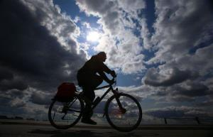 A man rides his bicycle in this 2014 file photo.