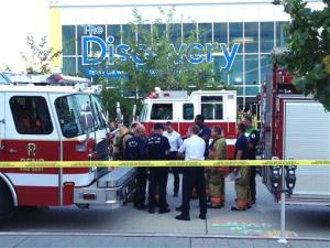 Firefighters confer outside the Nevada Discovery Museum in Reno yesterday.